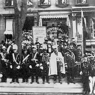 Marcus Garvey and other U.N.I.A. leaders in front of U.N.I.A. Publishing House in Harlem, NY